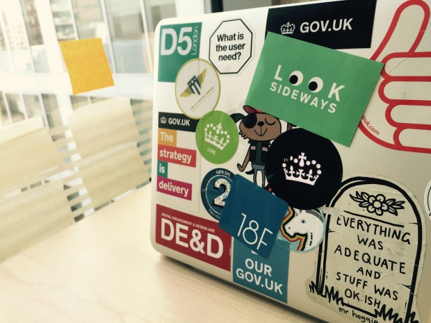 "Photo of a laptop covered in GDS stickers - including a ""Look Sideways"" sticker"