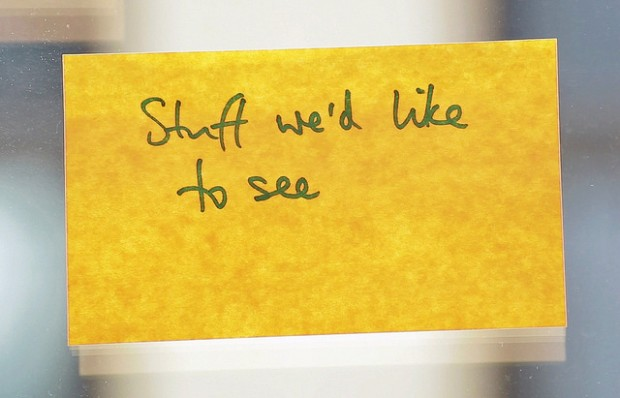 Post-it note with 'stuff we'd like to see' written on it