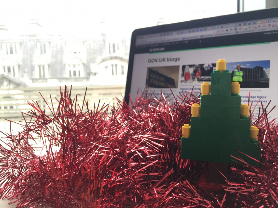 Tinsel and a Lego Christmas tree in front of a laptop showing the GOV.UK blogs homepage