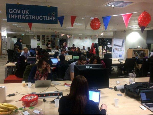Photo of students and coaches of Codebar working at the GDS offices in Aviation House, Holborn.