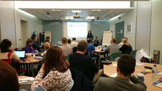 GDS speaker talking at the Digital by Default Assessment