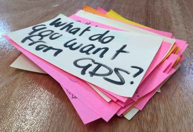 """Pile of sticky notes - top one reads """"what do you want from GDS?"""""""