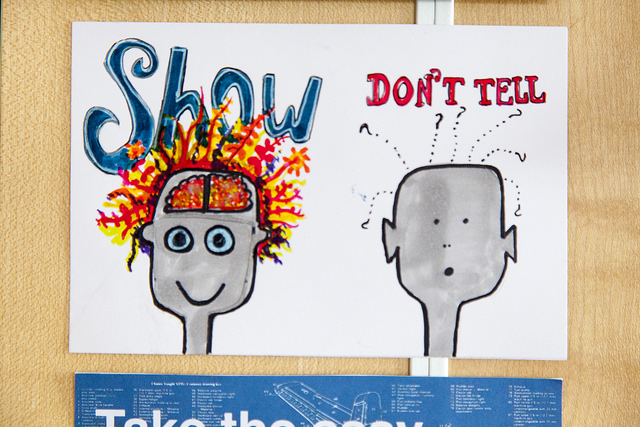 "illustration of two heads - one with the word ""show"" and lots of colourful activity appearing to spill from the brain, the other saying ""don't tell"" with a closed cramium and a sad expression. Representing the notion of 'show, don't tell' - of being open and transparent."