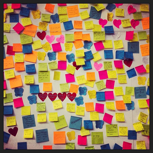 lots of post it notes on a wall
