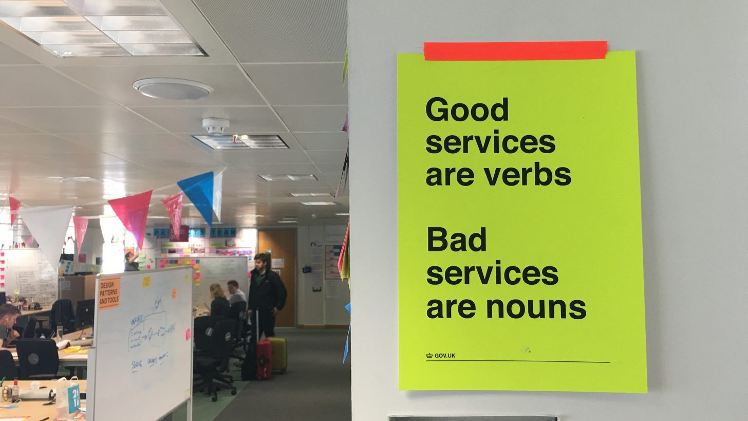 Poster with the words 'good services are verbs, bad services are nouns'