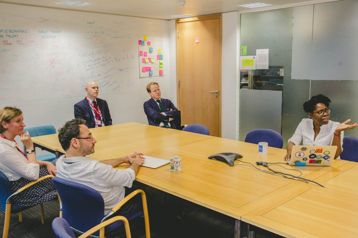 Ben Gummer and others around a table in the GDS office