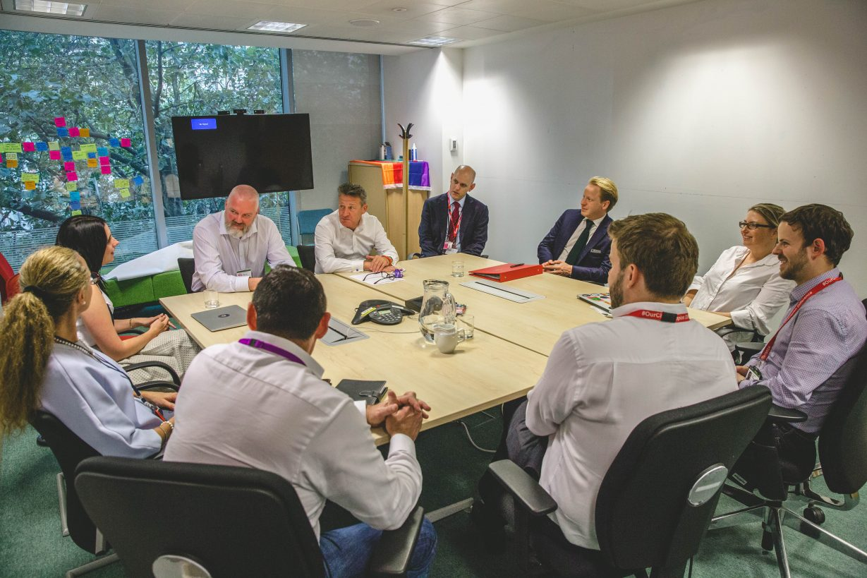 Ben Gummer, Kevin Cunnington and others around a table in the GDS office