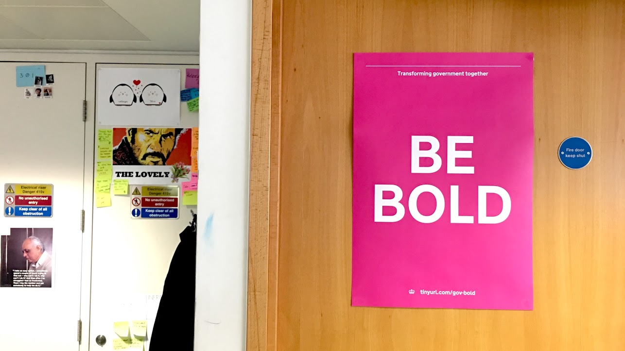 "A poster with the words ""Be bold"""