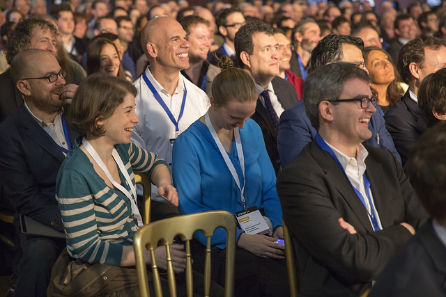 Photo of the audience at Sprint 14 laughing at something on the stage.