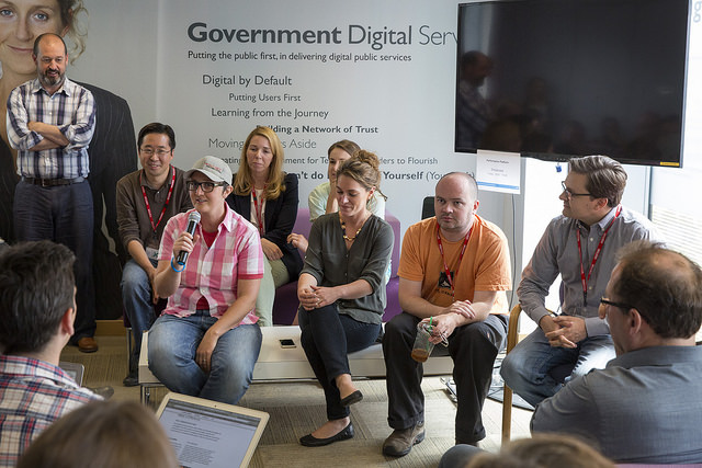 Members of the US Digital Service and 18F teams talking to GDS.