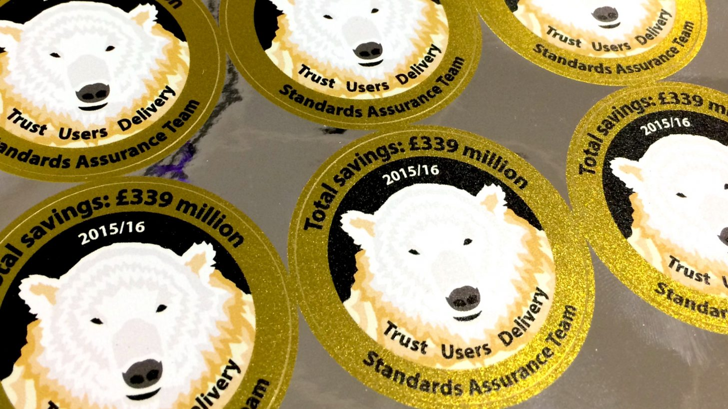Stickers with a polar bear on them, saying: Total savings £39 million