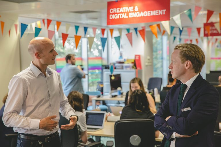 Photo of Minister for the Cabinet Office Ben Gummer talking to Ashley Stephens, Programme Director for Government as a Platform, in the GDS office.