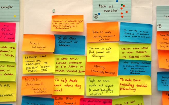"Sticky notes on a wall at the start of the Cabinet Office Technology Transformation project. A prominent note at the top says ""tech as enabler""."