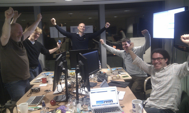 5 GDS developers celebrate the activation of redirects from Directgov and Business Link to GOV.UK, in the early hours of the morning on 17th October 2012