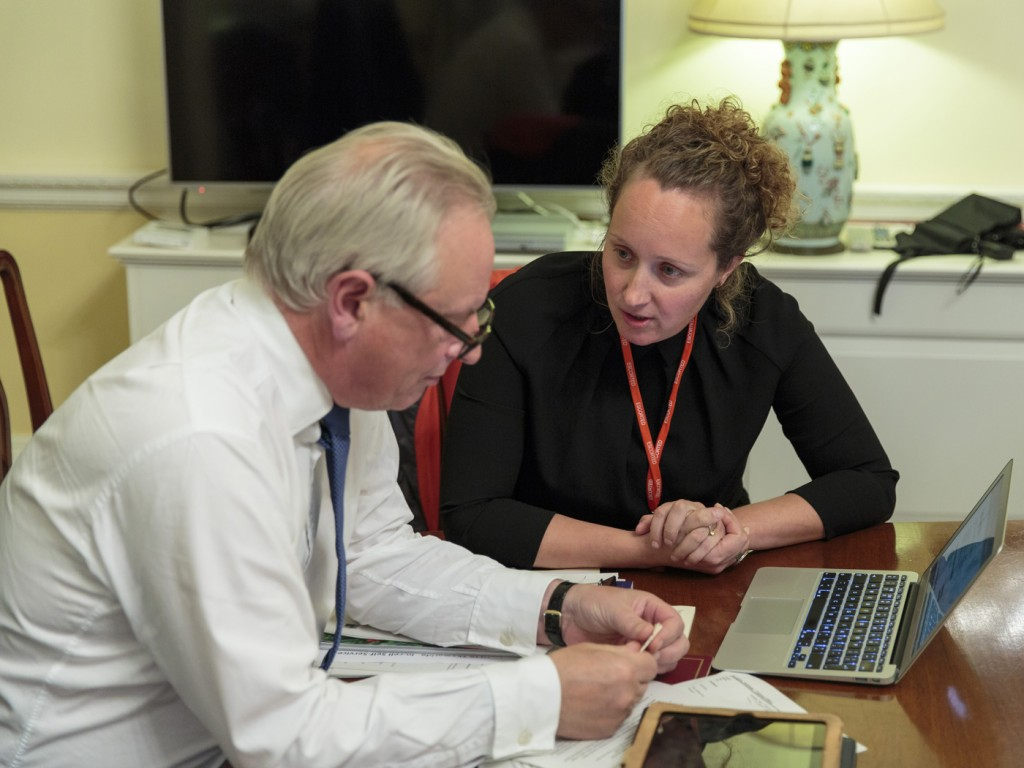 Photo of Francis Maude trying out the new Digital Marketplace, with help from Ivanka Majic.