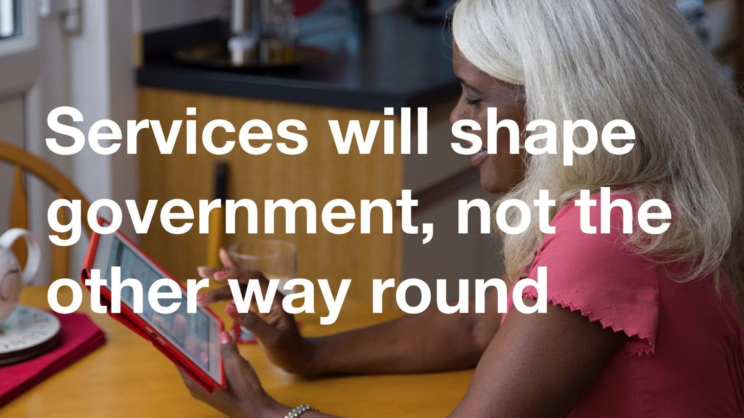 "A slide from Stephen Foreshew-Cain's talk about his vision for GDS. A photo shows a woman using GOV.UK on an iPad at home. Superimposed text reads: ""Services will shape government, not the other way round."""