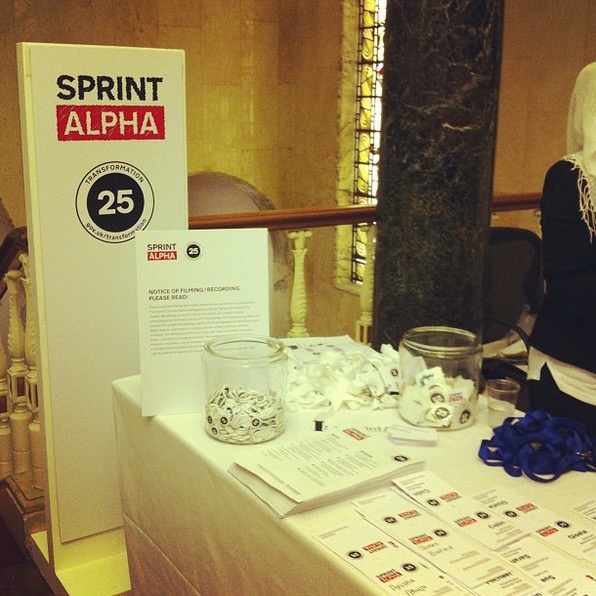 A photo of the welcome stand at the Sprint Alpha event.