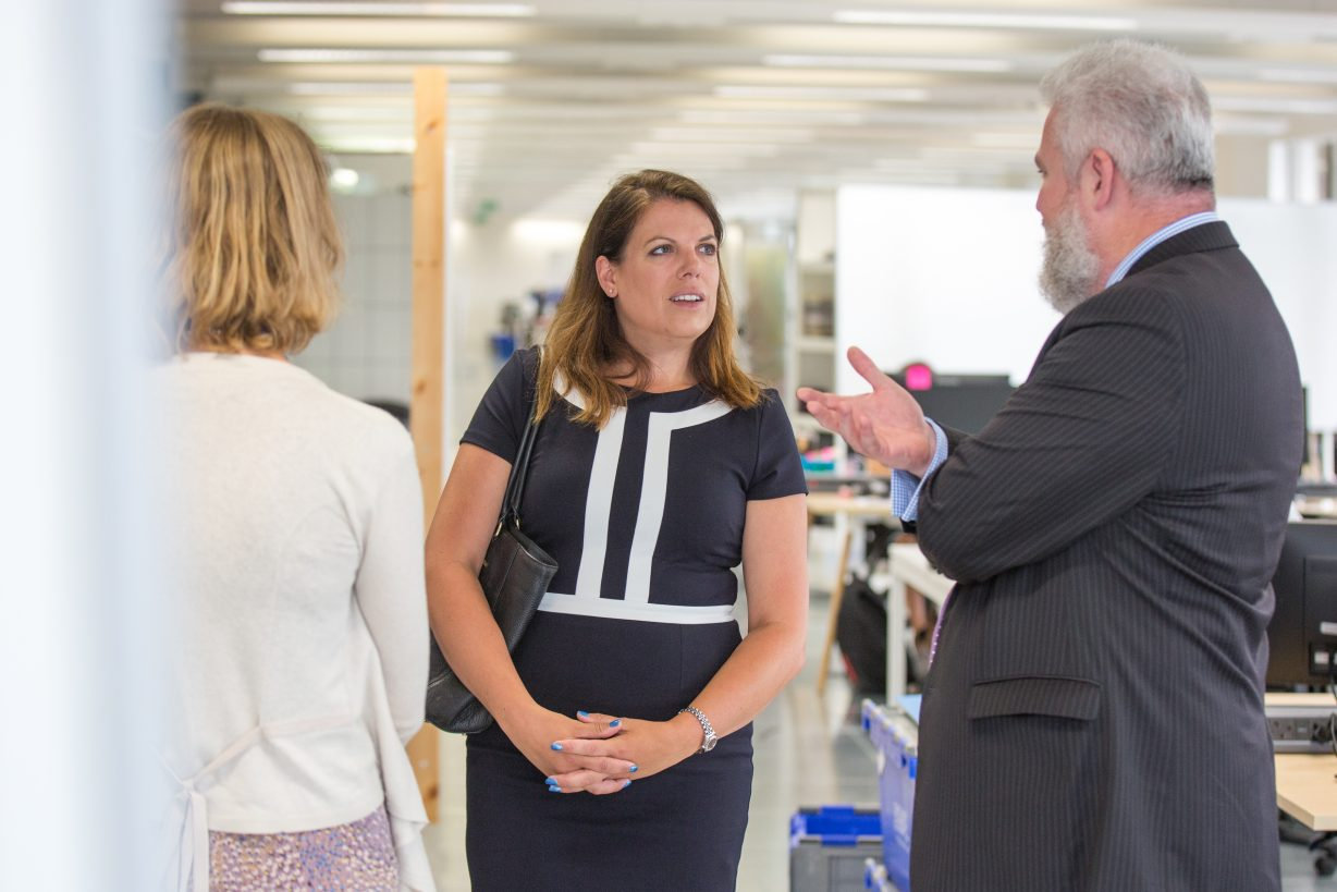 Parliamentary Under-Secretary of State Caroline Nokes in GDS offices, talking to two members of staff