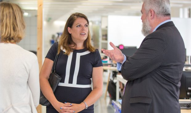 Caroline Nokes talking to 2 members of GDS staff