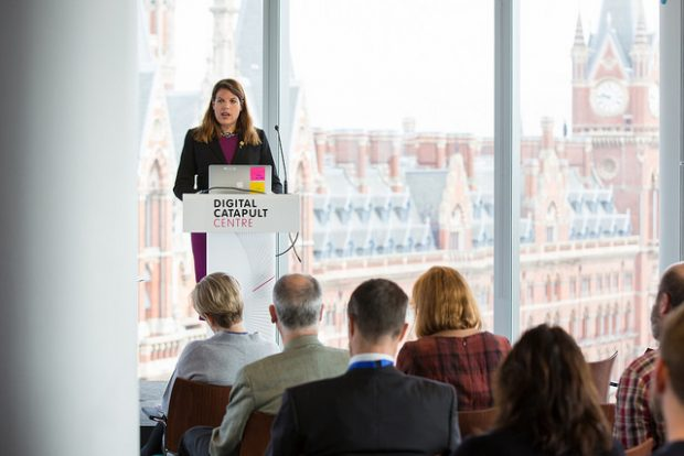 Caroline Nokes, Minister for Government Resilience and Efficiency speaking to a group of people on a stage