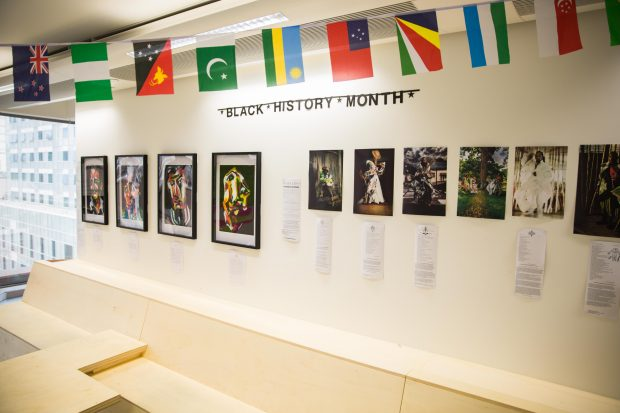 An art gallery set up in the GDS office to celebrate Black History Month - photographs, paintings and international flags.