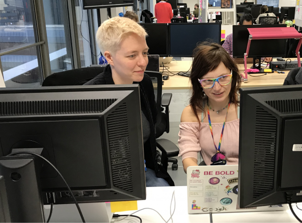 GDS staff pair programming, looking at a screen together