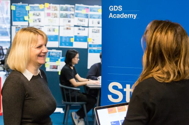 2 people standing in front of a sign reading 'GDS Academy'