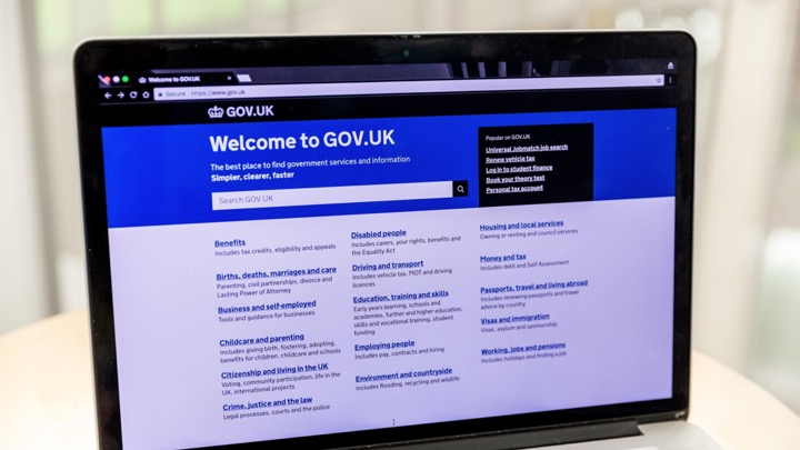 A laptop showing the GOV.UK homepage