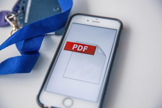 A mobile phone with a PDF logo on the screen