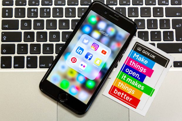 An iPhone displaying the social media icons for Facebook, Twitter, Instagram, Pinterest, Snapchat and LinkedIn