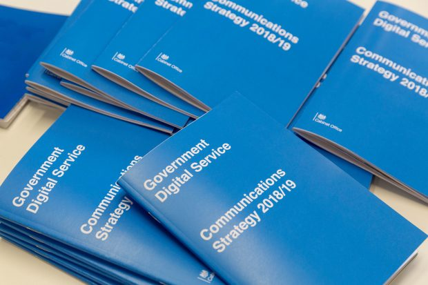 Copies of the GDS Communications Strategy booklet on a table