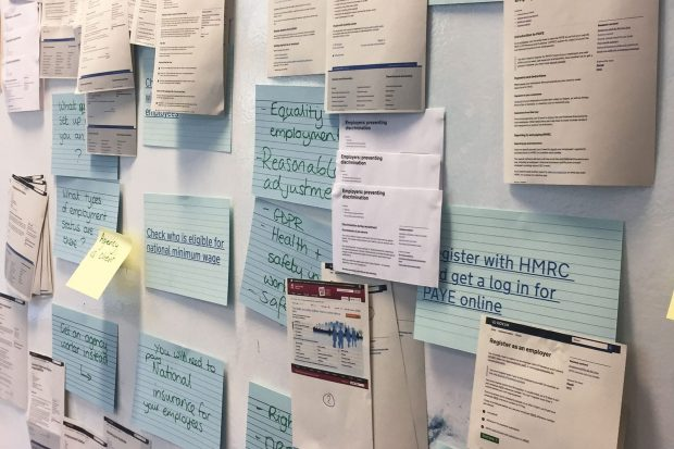 A pin board with lots of cards and paper attached showing different services including 'Register with HMRC and get a log in for PAYE online' and 'Check who's eligible for national minimum wage'