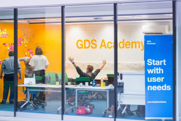 Photo of the GDS Academy classroom and person celebrating