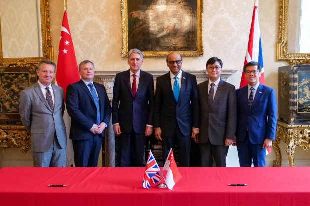 Kevin at the signing of a memorandum of understanding between the UK and Singapore governments