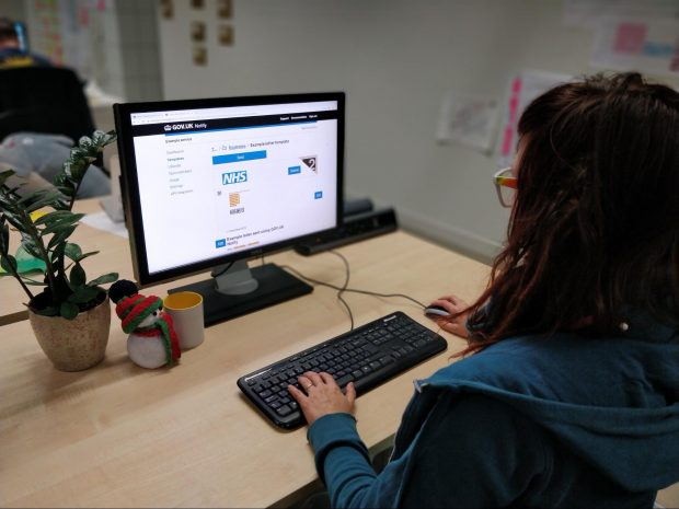 user sitting at a desk using a computer