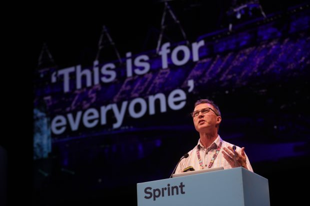 "Richard Morton speaking at Sprint with a background stating ""This is for everyone"""