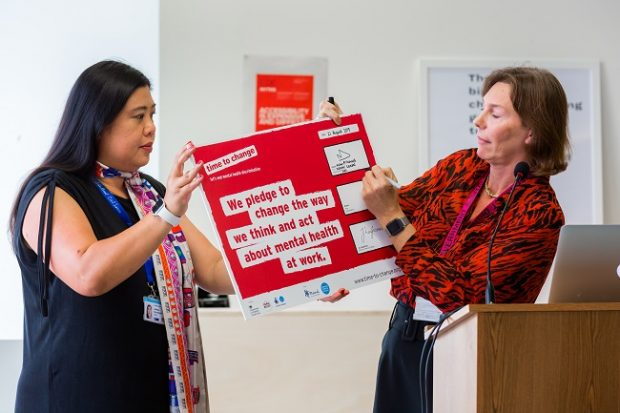 Alison Pritchard holds and signs the Time to Change pledge