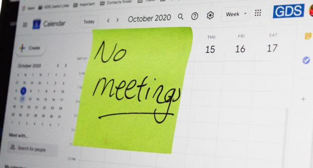 "Screen showing October 2020 calendar with a sticky note stuck on the screen, reading ""No meetings""."