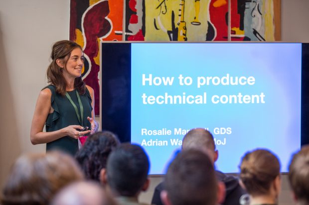 One of the ConCon sessions - a TV screen reads: How to produce technical content.