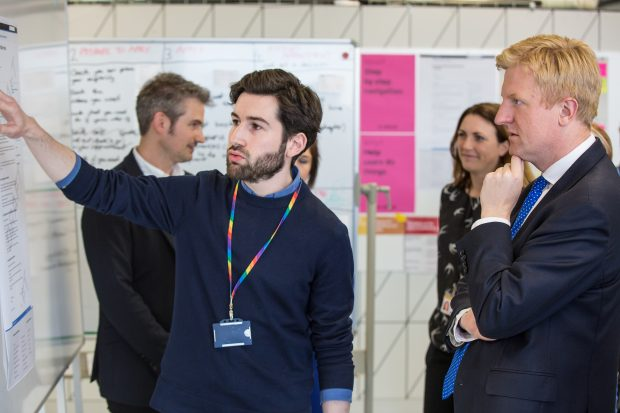 A GDS staff member explaining something to our Minister, Oliver Dowden.